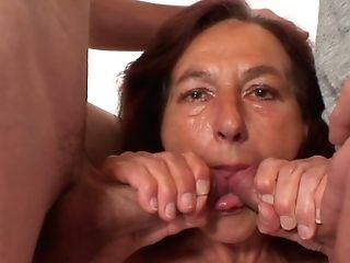 Horny Granny Takes Two Youthfull Dicks