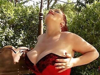 Curvy Red-haired Joanna Bliss Clothed In Crimson Shows Off Her