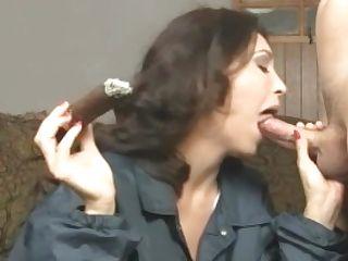 Brown-haired Cougar Charlee Chase Smokes Cigar & Bangs A Big Dick!